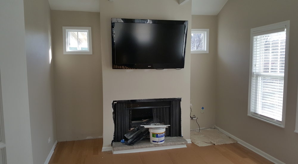 The family room gets a new fireplace and spot for the t.v.