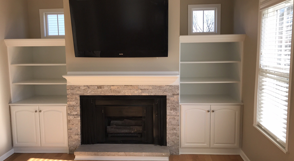 Built in bookshelves flank the new fireplace