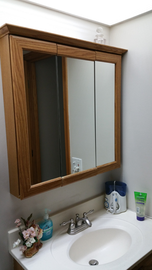 Old style mirror with medicine cabinet