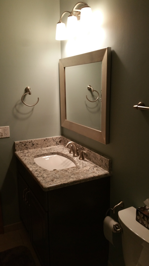 Sink area becomes more interesting with nice mirror and granite countertop