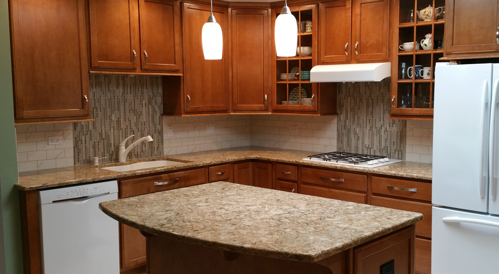 Granite counters and countertop stove. Note the backsplashes.
