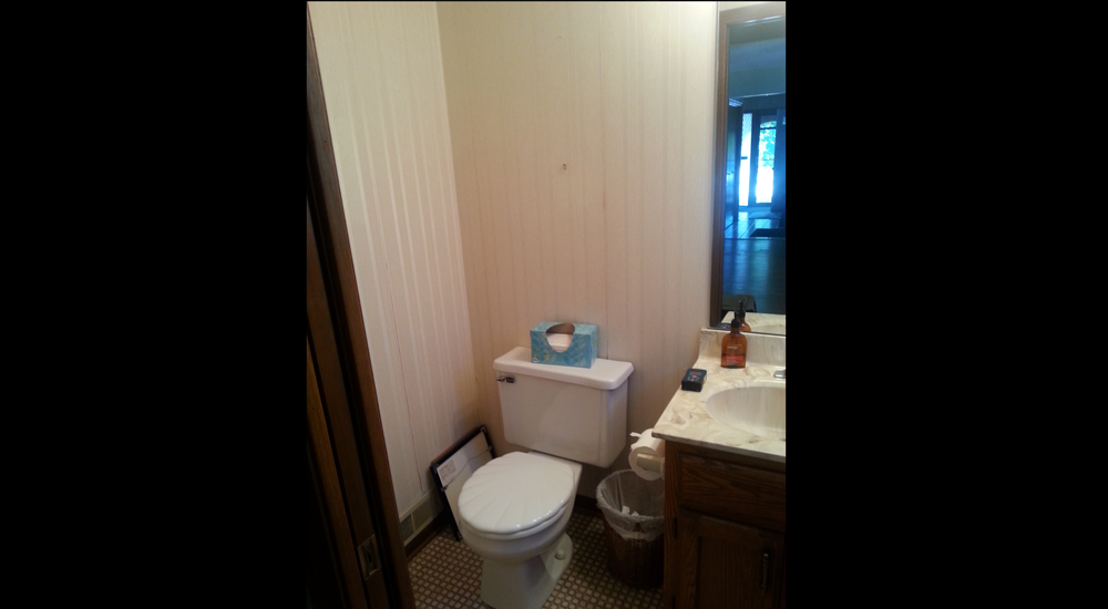 Dated small powder room