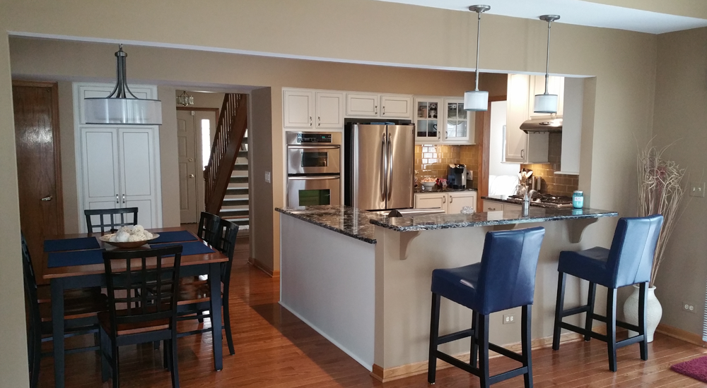 Removing the wall opens the kitchen up for a more modern look