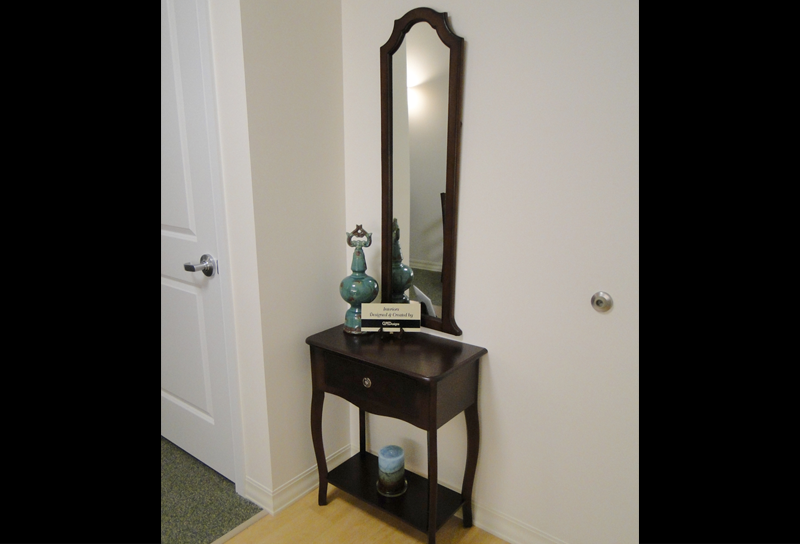 Entryway with small desk to hold purchases
